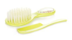 Small hairbrush and brush for the child Royalty Free Stock Photos