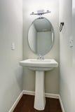 Small half bathroom with hardwood floor. Royalty Free Stock Images