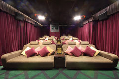Small hall of cinema with soft couches with pillows Stock Images