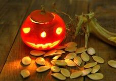 Small halloween pumpkin candle lantern head jack stock photography