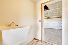 Small hallway with sink and exit to garage Stock Photos