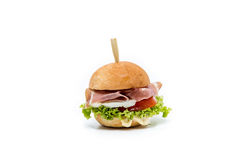 Small hamburger canapes on white. Small juicy hamburger canapes on white Royalty Free Stock Photo