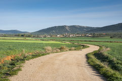 Small hamlet in La Mancha, Spain. Small hamlet in an agricultural landscape in La Mancha, Ciudad Real Province, Spain. In the background can be seen the Toledo Royalty Free Stock Images