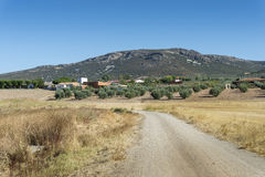Small hamlet in La Mancha, Spain. Small hamlet in an agricultural landscape in La Mancha, Ciudad Real Province, Spain. In the background can be seen the Toledo Stock Photos