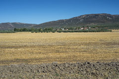 Small hamlet in La Mancha, Spain. Small hamlet in an agricultural landscape in La Mancha, Ciudad Real Province, Spain. In the background can be seen the Toledo Royalty Free Stock Photography