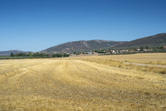 Small hamlet in La Mancha, Spain. Small hamlet in an agricultural landscape in La Mancha, Ciudad Real Province, Spain. In the background can be seen the Toledo Stock Photography