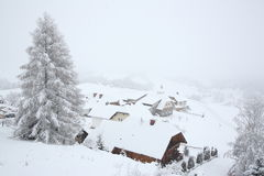 Small hamlet in mountains. A small hamlet inn in the mountains covered with snow Royalty Free Stock Images
