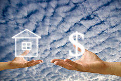 Small hand exchange the house with money Royalty Free Stock Photos