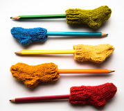 Small, hand knitted woolen socks with a color pencils Royalty Free Stock Image