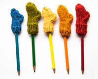 Small, hand knitted woolen socks with a color pencils Royalty Free Stock Photo