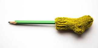 Small, hand knitted woolen socks with a color pencils Stock Photography