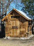 Small hand-made wooden sugar shack garden shed stock photos