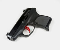 Small Handgun with Red Trigger Royalty Free Stock Photos
