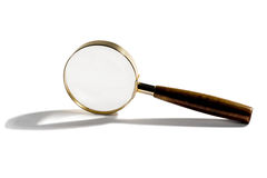Small handheld magnifying glass Royalty Free Stock Photos