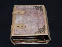 Small handmade ancient-looking photoalbum, general view.  Royalty Free Stock Photo