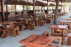 Small handmade tables and chairs in restaurant  stock images