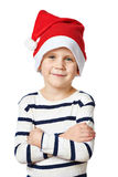 Small handsome boy in red Santa hat isolated Royalty Free Stock Photos