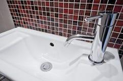Small handwas basin. Small ceramic hand wash basin with mosaic tiles Stock Photos