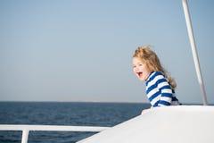Small happy baby boy captain of yacht in marine shirt Stock Photo
