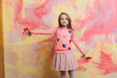 Small happy baby girl holding valentines day decorative red hearts Stock Photos