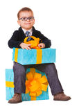 Small happy boy in spectecles with big present. Small happy boy in spectacles with big presents on white background Royalty Free Stock Photos