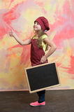 Small happy girl chef in hat, apron with blackboard Stock Photography
