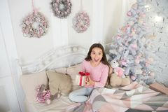 Small happy girl at christmas. Kid enjoy the holiday. Happy new year. morning before Xmas. New year holiday. little. Child girl likes xmas present. surprise royalty free stock images