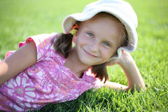 Small happy girl enjoys summer day. Royalty Free Stock Image