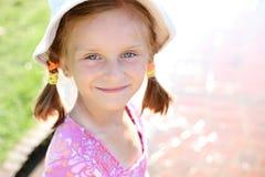 Small happy girl enjoys summer day. Royalty Free Stock Photos
