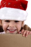 Small happy girl in paper box Stock Photography