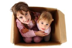 Small happy girls in paper box Stock Image