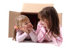 Small happy girls in paper box Royalty Free Stock Photos