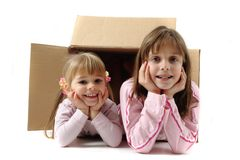 Small happy girls in paper box Royalty Free Stock Photography