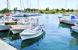 Small harbor with boats in Aegean island Greece Stock Images