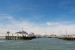 Small harbor Dutch island Texel. Small harbor in Oudeschild at Dutch wadden island Texel stock photo