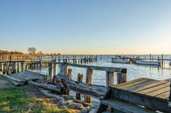 Small harbor with fishing boats in the sunset Stock Photo