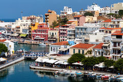 Small harbor with moored fishing boats at Aghios Nikolaos town on Crete island, Greece Stock Photography