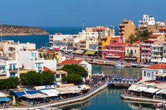 Small harbor with moored fishing boats at Aghios Nikolaos town on Crete island, Greece Royalty Free Stock Photo