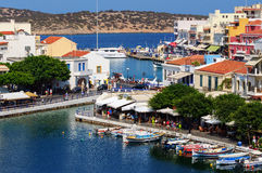 Small harbor with moored fishing boats at Aghios Nikolaos town on Crete island, Greece Royalty Free Stock Image