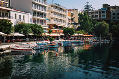 Small harbor with moored fishing boats at Aghios Nikolaos town on Crete island, Greece Stock Images