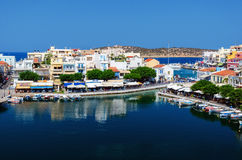 Small harbor with moored fishing boats at Aghios Nikolaos town on Crete island, Greece Stock Image