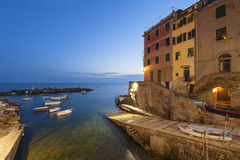 Small harbor of Riomaggiore at dusk. Small harbor of Riomaggiore, part of Cinque Terre, in Northwestern Italy. Long exposure, captured at dusk Royalty Free Stock Image