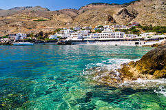 Small harbor with village at south side of Crete island Stock Images