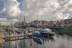 Small harbor in the village. View of the historic town in the Dutch province Royalty Free Stock Photos