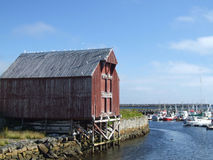 Small harbour. Wooden warehouse in a small Norwegian harbor Stock Photography