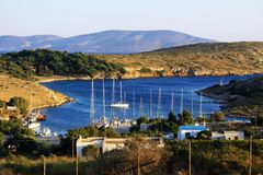The small harbour of Arki, Greece. stock images