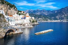 Small haven of Amalfi village with white houses, located on the rock, Amalfi coast, Italy royalty free stock photo
