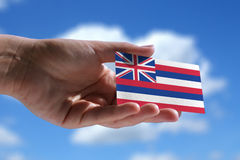 Small Hawaiian flag. Against sky with cumulus clouds Royalty Free Stock Photography