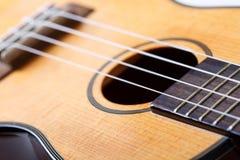 Small Hawaiian four stringed ukulele guitar Royalty Free Stock Image