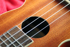 Small Hawaiian four stringed ukulele stock photography